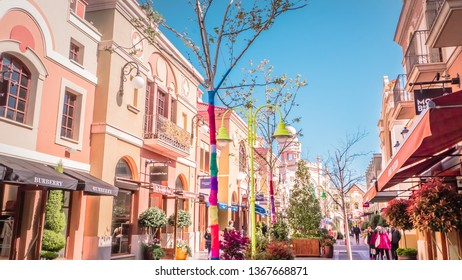 Madrid / Spain - 03 30 2019: Las Rozas village is an open-air shopping village with pedestrianized streets with luxury outlet fashion boutiques of known Spanish and international brands.