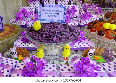 """MADRID, SPAIN - 03 APRIL, 2018: Perfect assortment of candies from violets and gift sets in the popular store """"La Violeta"""" of Madrid. Here you can purchase an unusual, special gift from Madrid."""