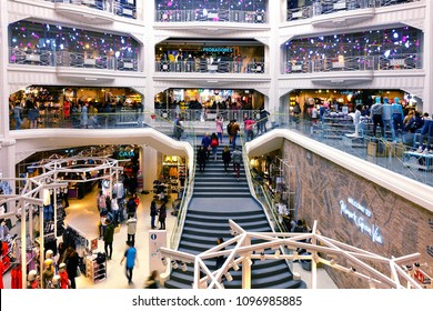 """MADRID, SPAIN - 04 APRIL, 2018: The interior of shopping center """"Primark"""" in the center of Madrid on Gran Via street. Gran Via is an ornate and upscale shopping street located in central Madrid."""