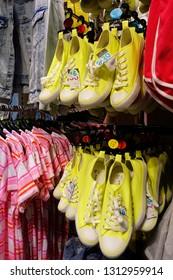 """MADRID, SPAIN - 04 APRIL, 2018: clothes and shoes of shopping center """"Primark"""" in the center of Madrid on Gran Via street. Gran Via is an ornate and upscale shopping street located in central Madrid."""
