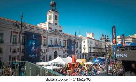 Madrid / Spain - 05 31 2019: Soccer fans of Liverpool and Tottenham teams are walking downtown Madrid between UEFA Championship League decorations at Puerta del Sol main square before the final match