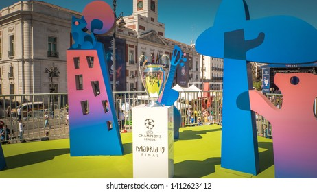 Madrid / Spain - 05 31 2019: UEFA Championship League real trophy is on the podium among other decorations at Puerta del Sol main square for soccer fans to take pictures with before the final match