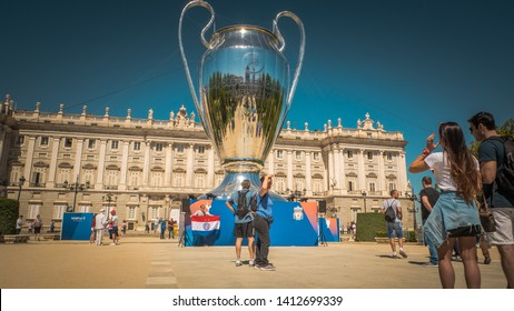 Madrid / Spain - 05 31 2019: A huge installation of the UEFA Championship League trophy is located in front of the Royal Palace at Oriente Square before the Liverpool and Tottenham final match
