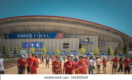 Madrid / Spain - 06 01 2019: Soccer fans are taking pictures in front of the Wanda Metropolitano stadium the UEFA Champions League before the final match between Liverpool and Tottenham teams.