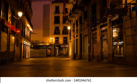 Madrid / Spain - 08 11 2019: Empty illuminated street by night in Madrid, Spain downtown area located near Puerta del Sol main square in the Spanish capital city.