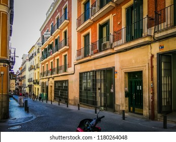 Madrid, Spain; 08 16 2017: A photo of one of the traditional Spanish architecture and narrow streets that tourists can find in the Barrio De Las Letras, also known as Barrio De Los Literatos or Musas.