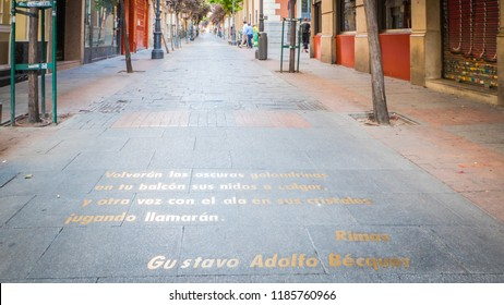 Madrid / Spain - 08 16 2018: Letters on the pavement floor from Gustavo Adolfo Becquer at the Calle de las Huertas street in the literary quarter downtown Madrid, capital of Spain.