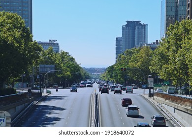 Madrid, Spain. 10 16 2018. Car traffic on the famous Paseo de la Castellana street in Madrid. Photograph taken at the exit of the tunnel located over the Plaza de Castilla roundabout on a sunny day.