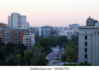 Madrid, Spain. 10 24 2018. Sunrise in the center of Madrid. Vehicle traffic of people heading to work on Paseo de la Castellana street as they pass the Intercontinental hotel.