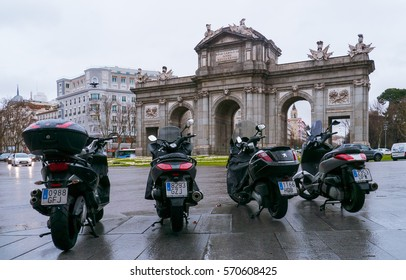 MADRID, SPAIN - 11 FEBRUARY, 2014: Four parked motorcycle on the background at Puerta de Alcala monument