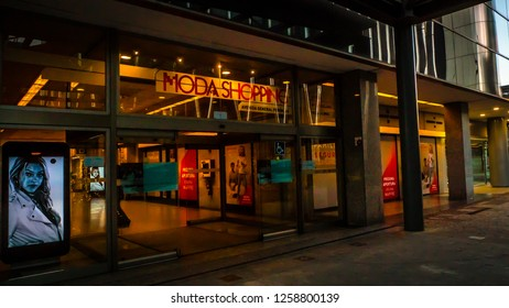 Madrid / Spain - 12 14 2018: Moda shopping mall next to the Torre de Europa tower, modern business office building view in financial district famous Azca neighborhood at sunset downtown Madrid, Spain