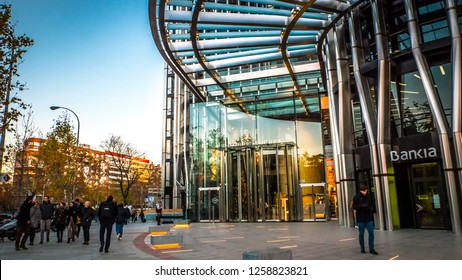 Madrid / Spain - 12 14 2018: Torre de Europa tower, modern business office building main entrance in the financial district famous Azca neighborhood at sunset downtown against the blue sky