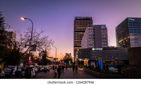 Madrid / Spain - 12 14 2018: Adeslas, BBVA, Gmp, Cajamar office buildings panoramic view at the Picasso square in the Azca neighborhood financial district at Paseo de la Castellana street by night