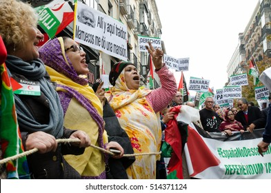 MADRID, SPAIN - 12 November, 2016: Women shouting and doing the victory sign with the hand during the demonstration for a free Sahara held in Madrid.
