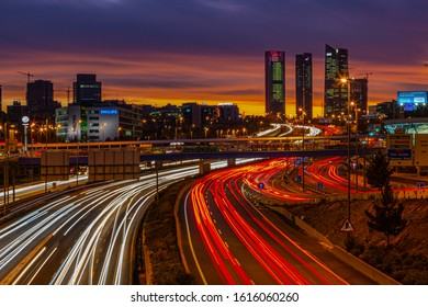 Madrid, Spain 12/23/2019 view from the A1 highway on the four towers (quattro torres) in Madrid during sunset with light trails and amazing colours in the sky