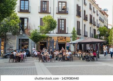 Madrid, Madrid, Spain 13  06 2019 Santa Barbara Square in Malasaña, University District. traditional terrace and people gathering at sunset.