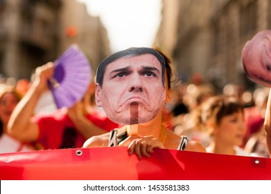 Madrid, Spain - 14 july 2019: funny close up protesters march in madrid city center against socialist party spanish prime minister Pedro sanchez holding mask and banner