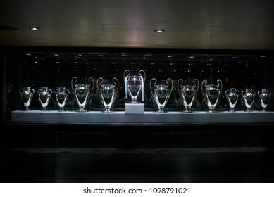 MADRID, SPAIN - 17 MAY, 2018: Detail on the Champions League cups awards in the Santiago Bernabeu Museum. In May 26, 2018 Real Madrid competed against Liverpool to get their 13th thirteenth trophy