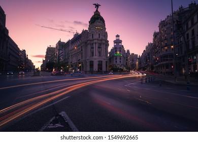 Madrid, Spain, 2019 November 3. Cars moving in Gran Vía Street at sunset in Madrid Central