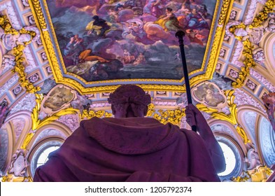 """Madrid, Spain - 23 September 2018: The ceiling and the fresco Corrado Giaquinto """"Spain Pays Homage to Religion and to the Church"""", seen from the point of view of the roman statue. Palacio Real."""