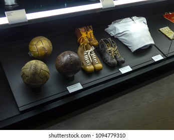MADRID, SPAIN - 25 MARCH, 2018: Detail on antique boots, shirts and soccer balls used by Real Madrid footballers along history showed in the Real Madrid Awards Museum