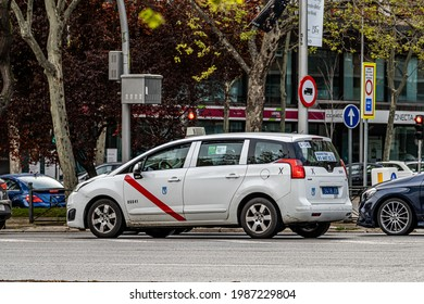 Madrid, Spain. 3 April 2021. Radio cab stopped with other vehicles at a traffic light on Paseo de la Castellana in northern Madrid.