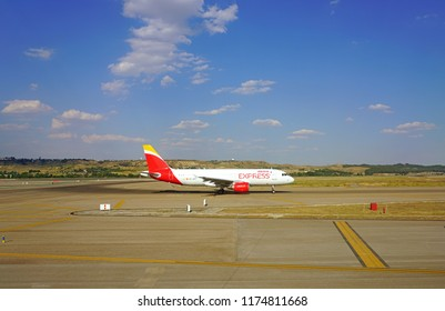 MADRID, SPAIN -9 JUL 2018- View of planes from Spanish flag carrier Iberia (IB) at the Adolfo Suarez Madrid Barajas Airport (MAD) .