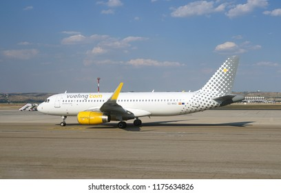MADRID, SPAIN -9 JUL 2018-  An airplane from Spanish low-cost airline Vueling (VY) at the Adolfo Suarez Madrid Barajas Airport (MAD).