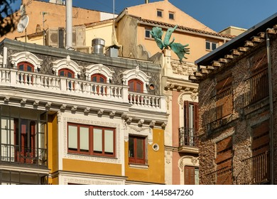 Madrid, Spain. Air accident. The sculpture of angel on the roof of the house, the sculptor Miguel Angel Ruiz. Bronze figure adorns the fasade of a building on Calle Milaneses, near to the Plaza Mayor.