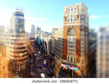 """Madrid, Spain - APRIL 02, 2018: Top view on  Gran Via street.  Gran Vía (literally """"Great Way"""") is an ornate and upscale shopping street located in central Madrid."""