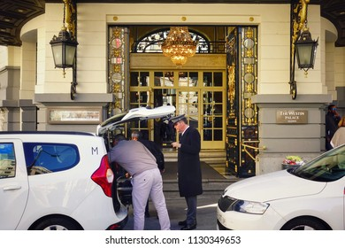 """Madrid, Spain - April 02, 2018: hotel employee greets visitors at the main entrance of the hotel """"The Westin Palace"""""""