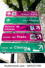 MADRID, SPAIN - APRIL 04, 2018: Street signs leading to famous museums of Madrid Prado and the Nacional Centro de Arte Reina Sofia and to some other popular tourist sightings of the city.