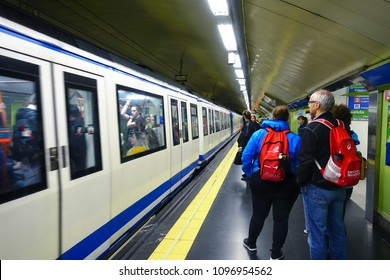 MADRID, SPAIN - APRIL 04, 2018:  Passengers are getting ready for boarding a subway train. Annually Madrid subway transports more than 600 million people.