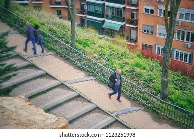 MADRID, SPAIN - APRIL 04, 2018: Unknown people walking down the street