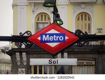 """MADRID, SPAIN - APRIL 04, 2018: Sign with the name of the metro station """"Sol"""" in Madrid. Madrid is a popular cultural and tourist destination."""