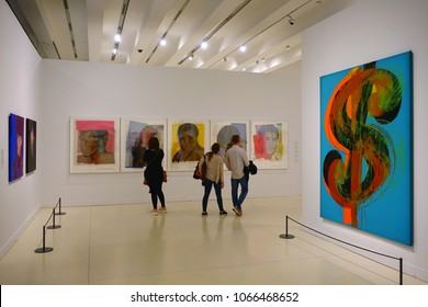 "MADRID, SPAIN - APRIL 05, 2018: Visitors in the CaixaForum Madrid consider pictures at the exibition Andy Warhol ""Warhol. Mechanical Art."""