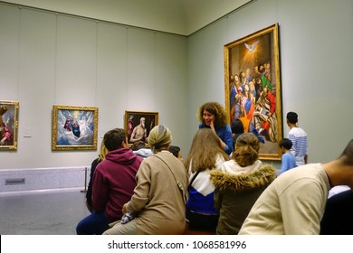 MADRID, SPAIN - APRIL 05, 2018: Visitors in the Prado Museum consider pictures. Museum Prado is the main Spanish nationalart museum, located in central Madrid.