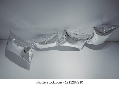 "MADRID, SPAIN - APRIL 05, 2018: Installation ""silver clouds"" in the CaixaForum Madrid at the exibition Andy Warhol ""Warhol. Mechanical Art."""