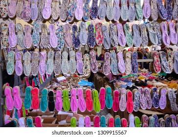 MADRID, SPAIN - APRIL 05, 2018: assortment of traditional Spanish Espadrilla shoes on the popular Rastro market.
