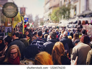MADRID, SPAIN - APRIL 05, 2018: people walk and look at the goods assortment on the popular Rastro market.