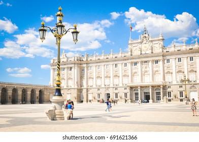 Madrid, Spain - April 10, 2016: Tourists visit the Royal Palace (Palacio Real), major cultural and historical landmark in Madrid, Spain
