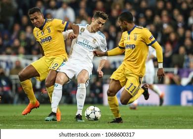 Madrid, Spain. April 11, 2018. UEFA Champions League. Real Madrid - Juventus 1-3. Cristiano Ronaldo, Real Madrid, between Alex Sandro and Douglas Costa, Juventus.