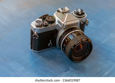 MADRID, SPAIN - APRIL 11, 2019: The Nikon FE is an advanced semi-professional level, 35 mm film, single-lens reflex (SLR) camera. It was manufactured by Nikon in Japan from 1978 to 1983. illustrative