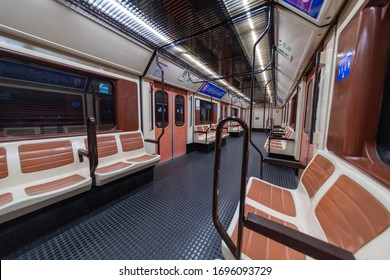 MADRID, SPAIN - APRIL 13, 2019: Inside empty Metro wagons on Line 9, an unusual sight for this type of transport. The Metro of Madrid is usually much busier during rush hour.