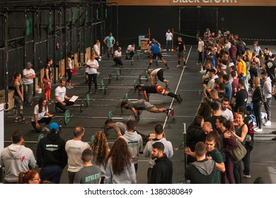 Madrid, Spain - April 14, 2019: Athletes realizing burpees in the 4th interbox crossfit league competition.