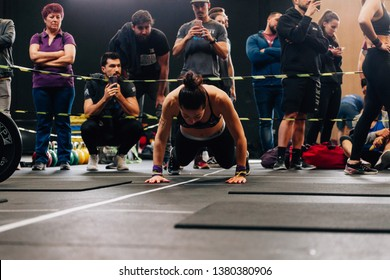 Madrid, Spain - April 14, 2019: Athlete realizing burpee in the 4th interbox crossfit league competition.