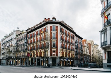 Madrid, Spain - April 15, 2018:  Serrano Street in Salamanca District a cloudy day. Salamanca is well known for being one of the wealthiest areas in Madrid, with a high living cost and luxury shops