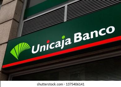 MADRID, SPAIN - APRIL 20, 2019. Unicaja banco logo on Unicaja bank office. Unicaja is a spanish savings bank