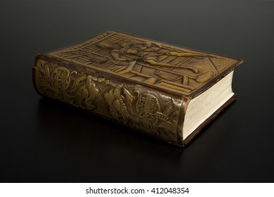 MADRID, SPAIN - APRIL 23, 2016: Miguel de Cervantes' Death Fourth Centenary. Old Embossed Leather Book Edition of The Ingenious Gentleman Don Quixote of La Mancha, Isolated on Dark Background