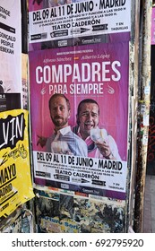 MADRID, SPAIN - APRIL 27, 2017: Billboards stuck on an outdoor wall